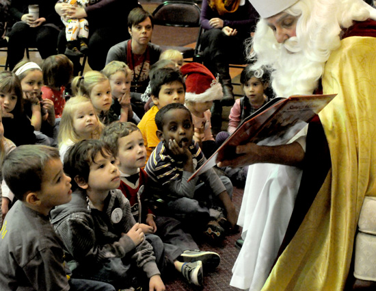 Children ages 2 to 6 were invited to spend a special St. Nicholas Fun Day  with preschoolers at the  school. Above, preschoolers, front row from left, Hank Hughes, Tomas Cortes, Jameson Johnston and Yonni Zelinskas listened intently to the story of St. Nicholas.