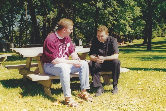 Then-Father Andrew Cozzens talks with Nathan Metzinger, who was training to be a NET missionary, in this photo from 1997.  Photo courtesy of NET Ministries