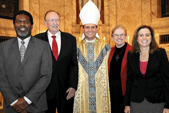 Bishop Andrew Cozzens, center, gathers with his family for a photo in the Cathedral of St. Paul after his ordination Mass Dec. 9. The others are, from left, Sergei Thomas (foster brother), Jack (father), Judy (mother) and Helen Healy (sister). Dave Hrbacek / The Catholic Spirit