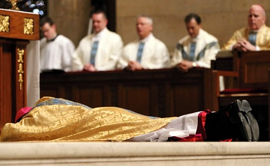 Bishop Cozzens lies prostrate during the Litany of Supplication.