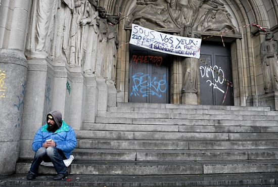 A panhandler sits at the entrance of the an abandoned convent Nov. 4 in Brussels. Pope Francis will help launch a global campaign of prayer and action against world hunger. CNS photo/Francois Lenoir, Reuters