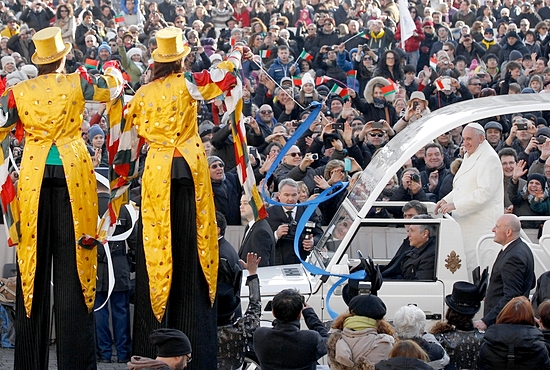 CIRCUS FUN Pope Francis passes circus performers on stilts as he arrives to lead his general audience in St. Peter's Square at the Vatican Jan. 8. CNS photo/Paul Haring