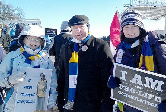 Joleen Johnson, left, and Katie Wratkowski, seniors at Totino-Grace High School in Fridley, stand with Bishop Lee Piché during the national March for Life Jan. 22 in Washington, D.C.  Photo courtesy of Lisa Boris