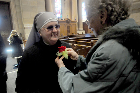 Sister of St. Joseph Mary Madonna Ashton, right, pins a corsage on Little Sister of the Poor Dorothy Struzinski, who celebrated her 25th jubilee this year.