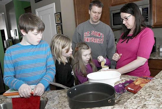 William, Alivia, Megan, Dan and Julia Rohda of St. Thomas Becket in Eagan plan to make meals and participate in other activities through Catholic Relief Services' Rice Bowl during Lent and throughout the year. Dave Hrbacek/The Catholic Spirit