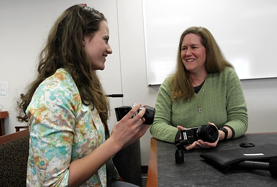 St. Catherine University sophomore Laura Crepeau, left, talks about her National Catholic Sisters Week video project with Dominican Sister Mary Soher, co-director of the initiative, made possible by a three-year, $3.3 million grant from the Hilton Foundation. Dave Hrbacek / The Catholic Spirit