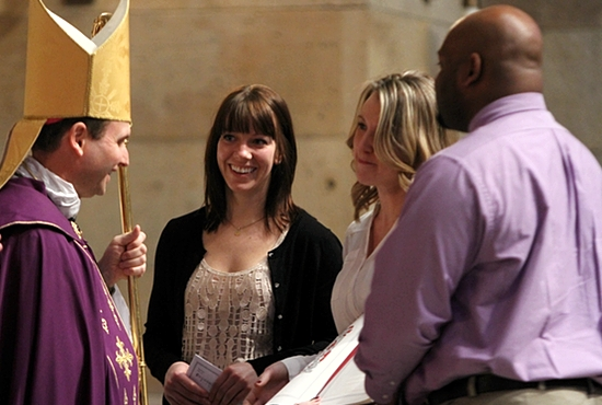 From left, Bishop Andrew Cozzens greets Kate Valiant, LaVonne Luker and Jareck Horton of Sts. Joachim and Anne in Shakopee during The Rite of Election and The Call to Continuing Conversion at the Cathedral of St. Paul March 9. Luker and Horton are catechumens, and Valiant is Luker's sponsor. The catechumens and sponsors all came forward to present themselves to Bishop Cozzens, carrying the Book of the Elect. A similar event took place at the Basilica of St. Mary in Minneapolis. Dave Hrbacek / The Catholic Spirit