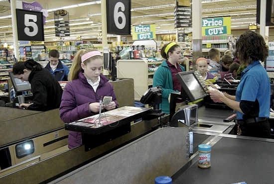 SOCIAL JUSTICE Seventh- and eighth-grade students from St. Hubert School in Chanhassen shopped at Cub Foods March 12, spending their own money to purchase groceries for families in need. The food was donated to People Reaching Out to Other People, a local food shelf and multiservice organization serving the Chanhassen and Eden Prairie area. The students each earned $10  themselves outside of school and stretched it to $20 using coupons. Photo courtesy of St. Hubert School