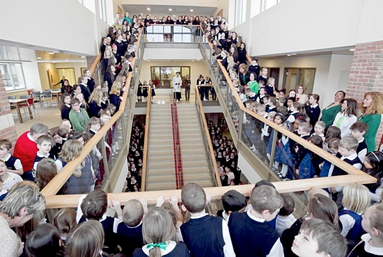 """GRAND OPENING The community of Convent of the Visitation School in Mendota Heights gathered March 17 to celebrate the grand opening of a new multilevel commons area called the Heart of the School, part of the Visitation Heart and Mind building project. The $10.5 million project also includes the Opus Hall for science, technology, engineering and math — which forms the """"mind"""" of the project — that opened in January 2013. Photo courtesy of Visitation School"""