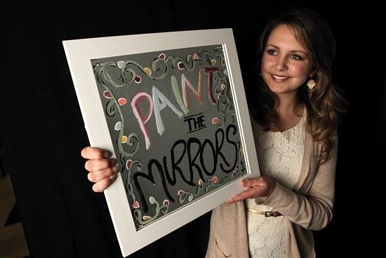 Angela Deeney of Holy Name of Jesus in Wayzata and a senior at the University of St. Thomas is embarking on her Lenten pledge to avoid looking in the mirror until Easter Sunday. As a reminder of her commitment, she has painted a message on her own mirror that conveys her theme for Lent. (Dave Hrbacek / The Catholic Spirit)