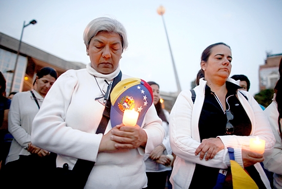 PEACE PRAYERS Anti-government protesters pray during a rally against violence in Caracas, Venezuela, March 5. Bishops in Caracas urged both the government and protestors to resist violence amid a deepening standoff in Venezuela that has further polarized the country and left church charities struggling. CNS photo/Tomas Bravo, Reuters