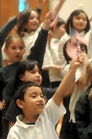 The kindergarten through third-grade students at Blessed Trinity performed a patriotic song as part of the program after Mass. In the foreground is Edwin Portillo; visible behind him are classmates Cassidy Gaston and Lila Martin as well as second-graders Ally Pellegrini and Theresa Nguyen.