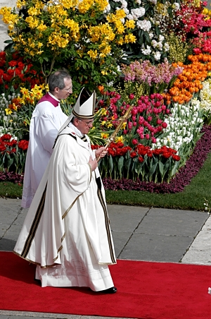Pope Francis walks to the altar to celebrate Easter Mass in St. Peter's Square at the Vatican last year. CNS/Paul Haring