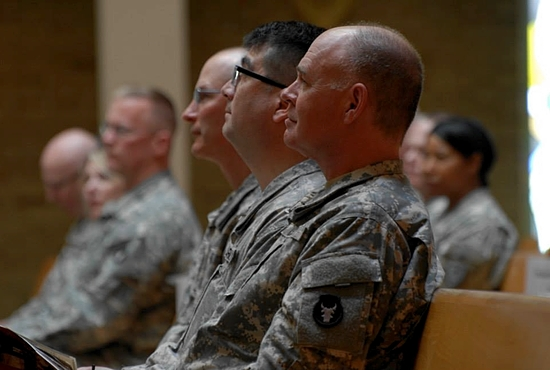 From right, Chaplain Maj. Richard Rittmaster sits with Staff Sgt. Steve Howe and Master Sgt. Tim Mellen during the Mass. Photo by Spc. Jess Nemec