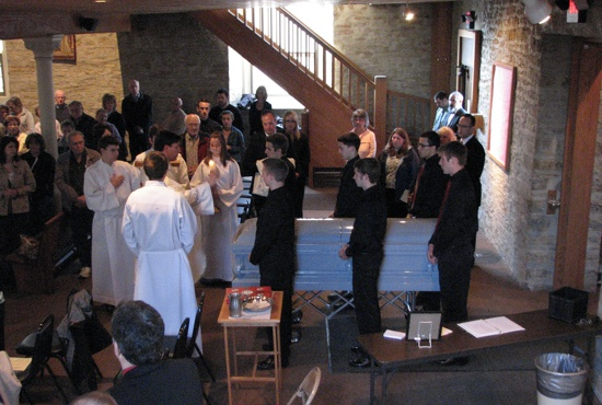 Students from Bethlehem Academy in Faribault served as pallbearers and attended the funeral of Mary Manahan at the Immaculate Conception site of Divine Mercy parish in Faribault April 11. Manahan was an alum of Bethlehem Academy and had few living relatives.  Photo courtesy of Rene Thompson, Bethlehem Academy