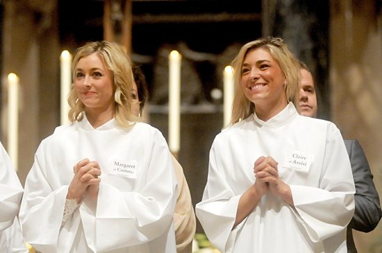 Jamie Hornnes, left, and her sister Jessie Hornnes, students at the University of St. Thomas, smile at the congregation after their baptisms. Dianne Towalski/The Catholic Spirit