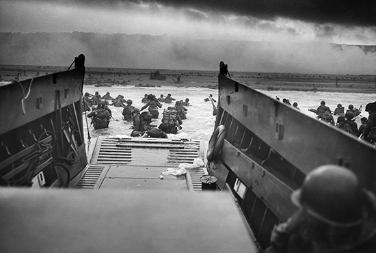 U.S. Army troops wade ashore on Omaha Beach on the morning of June 6, 1944.  Robert F. Sargent/United States Coast Guard