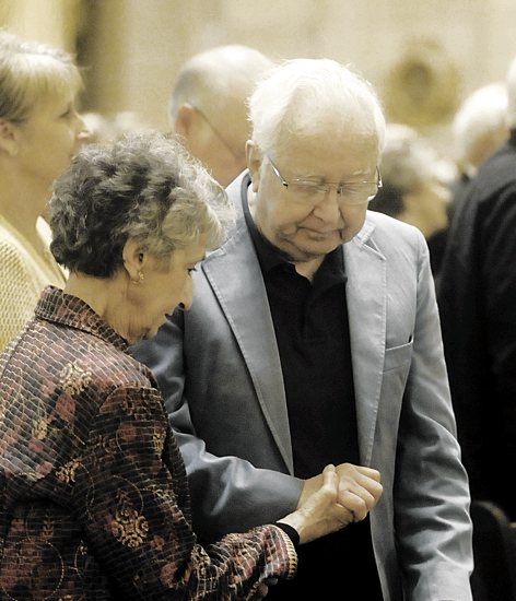 Bishop Lee Piché's parents, Leroy and Cecilia Piché of St. Charles Borromeo in St. Anthony pray together after they renewed their vows. They are celebrating 56 years of marriage this year.