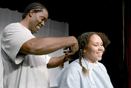 Sedrick McBounds, a barber in Minneapolis, cuts the hair of Maddie Hodapp during Cuts for a Cause at De La Salle High School in Minneapolis. Jim Bovin / For The Catholic Spirit
