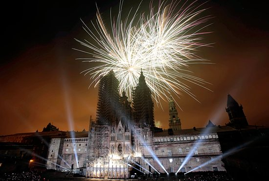 CELEBRATING A FEAST Fireworks explode over an ancient cathedral July 24 during celebrations for the feast of St. James the Apostle in Santiago de Compostela, Spain. CNS / Miguel Vidal, Reuters