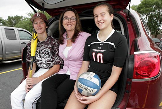 Ann Bergmann works hard to ensure that her two children, Alex, left, and Lauren, are able to attend Mass every Sunday even as they spend many weekends competing in sports tournaments. Dave Hrbacek/The Catholic Spirit