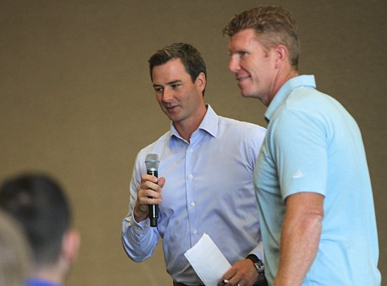 From left, former NFL player Brooks Bollinger and Matt Birk take turns at the microphone during the captains summit. Dave Hrbacek/The Catholic Spirit