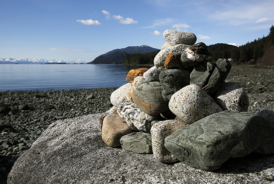 Stones left by mourners sit in pile on a rock near columbarium at Shrine of St. Therese in Juneau, Alaska