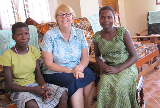 Maryknoll Lay Missioner Liz Mach (center) visits with Pascalia and Eliza, two girls who sought refuge from Female Genital Mutilation at Jipe Moyo, a shelter run by the Immaculate Heart sisters in the Tanzanian diocese of Musoma where Mach works. Photo courtesy of Novatus Mchele.