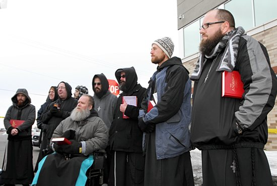 Third from left, Brother Paul O'Donnell, guardian of the the Franciscan Brothers of Peace, prays with members of his religious community at the Good Friday Prayer Service for Life in front of Planned Parenthood in St. Paul in this 2013 file photo. Brother Paul died Feb. 20. Dave Hrbacek/The Catholic Spirit
