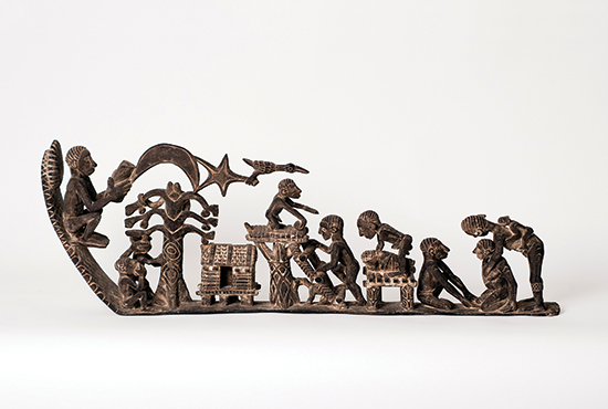"""""""Genesis,"""" by Asmat artisan Aleksander Wuru, a 5-foot long single piece of ironwood, elaborately tells the Christian story of creation, the temptation in the Garden of Eden, birth and death, within the context of Asmat culture. Photo courtesy American Museum of Asmat Art"""