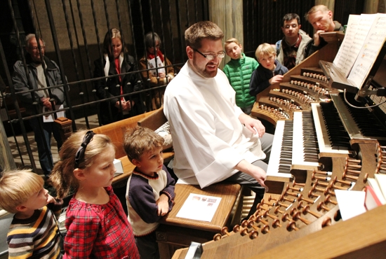 "Christopher Stroh, organist at the Basilica of St. Mary in Minneapolis, demonstrates how the instrument works during a tour after the 5 p.m. Mass Nov. 22 called ""At the Console."" The tour was scheduled to coincide with the Nov. 22 feast day of St. Cecilia, patron saint of musicians. Dave Hrbacek/The Catholic Spirit"