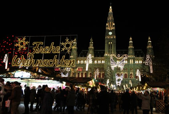People pack into the popular Christkindlmarkt to shop and see the Christmas illuminations in Vienna's Rathauspark Dec. 8. CNS photo/Chaz Muth