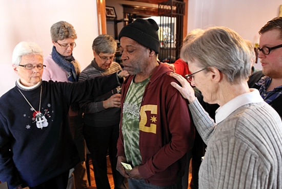 Elbert Watkins, center, receives prayer from the Visitation Sisters: Sister Katherine Mullen, left, Brenda Lisenby, Sister Mary Frances and Sister Karen Mohan