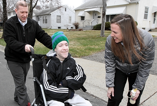 John, left, and Ann DeJak of St. Agnes in St. Paul enjoy a walk with their son Tom, the oldest of their eight children. Dave Hrbacek/The Catholic Spirit