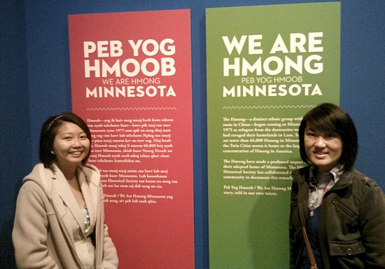 "Chia Lor, left, and her sister, Hillary, walked through the ""We Are Hmong Minnesota"" exhibit at the Minnesota History Center and shared their thoughts about the artifacts, displays and videos, and about their Catholic faith. Bob Zyskowski/ The Catholic Spirit"