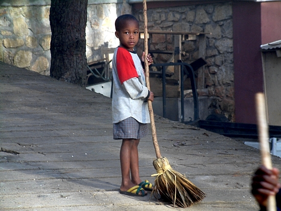 A boy in NPH's Haiti home does chores in this 2003 photo. Photo courtesy NPH USA
