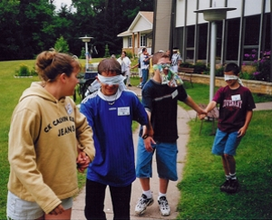 Trust walks, where blindfolded participants must let a partner guide them, have been part of Dunrovin retreat activities.  Courtesy Dunrovin