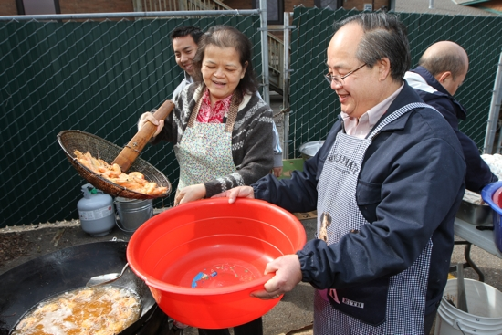 Therese Yang, left, and Geu Vu prepare shrimp for the celebration after Mass.