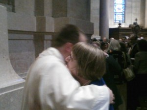 Father John Powers and his mother, Marge, hug after the son gave his mother his first blessing as a priest.