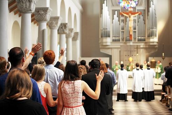 Students pray at Mass at St. Mary's Chapel at the St. Paul Seminary