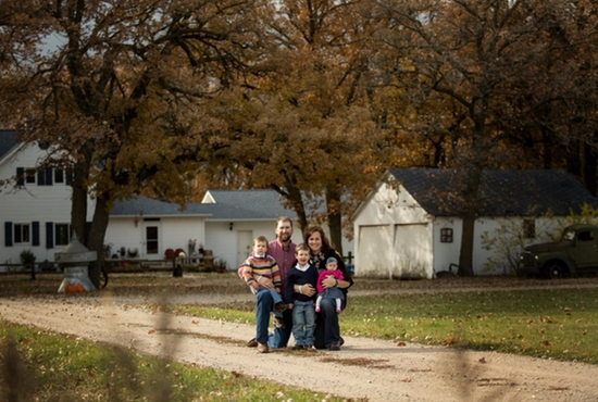 Aaron and Liz Rongen are pictured in front of their fifth generation homestead near Fertile, Minn. with their three children, John Douglas, Arthur and Mary Cate. Courtesy the Rongens