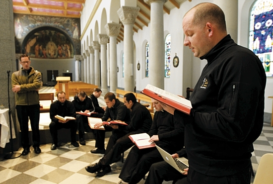 Deacon Byron Hagan,  right, practices singing during a class at the  St. Paul Seminary. At far  left observing is Deacon  Jake Anderson. Dave Hrbacek/The Catholic Spirit