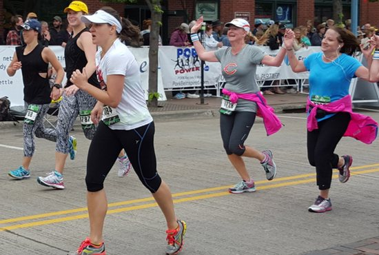 Susan Mulheron (white t-shirt) prepares to cross the finish line.
