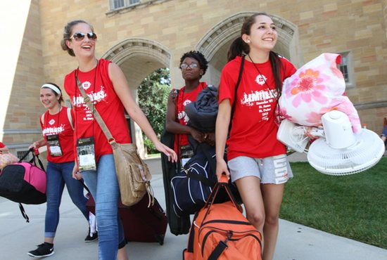 From left, Samantha Metallo, Paige Armbruster, Myanauh Lowe and Adela Sosa of St. Anne in Kenosha, Wisconsin, bring their belongings onto the University of St. Thomas campus in St. Paul July 24 for the annual Steubenville North Conference. Dave Hrbacek/The Catholic Spirit