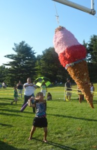 Youngsters took swings at a giant ice cream cone pinata.