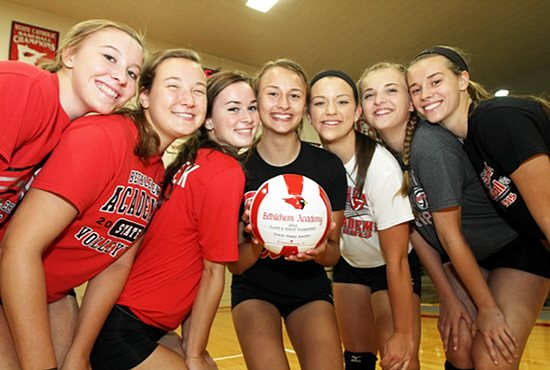 From left, Cardinals Payton Nutter, Nora Schulz, Keely Skluzacek, Hannah Robb, Shelby Meyer, Mary Campbell and Madi Strodtman bring state tournament experience to the Bethlehem Academy varsity volleyball roster this year. All played key roles on last year's state Class A championship team. Dave Hrbacek/The Catholic Spirit