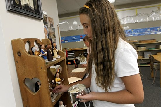 Fifth-grader Catherine Schue works to match names of saints with their figures/symbols. Dave Hrbacek/The Catholic Spirit