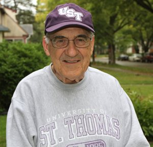 Deacon Jerry Devine can't remember the last time he missed a football game between the University of St. Thomas and St. John's University. He went to his first one in 1965. Dave Hrbacek/The Catholic Spirit