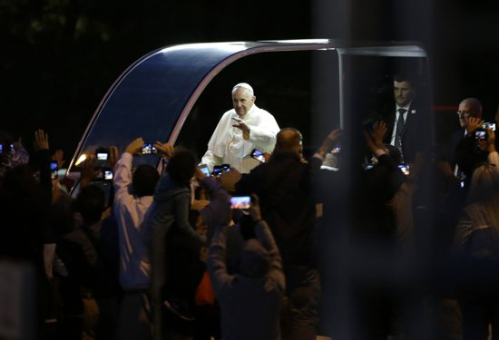 Pope Francis waves to crowds along Benjamin Franklin Parkway as he arrives for the Festival of Families for the World Meeting of Families in Philadelphia Sept. 26. CNS
