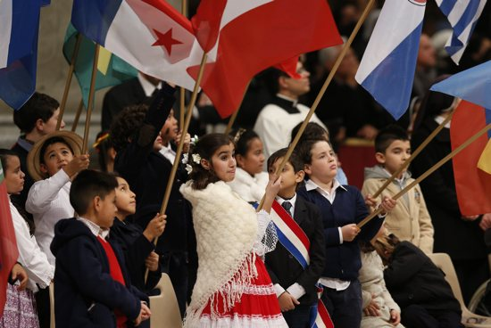 Children carry flags of American nations during a Mass marking the feast of Our Lady of Guadalupe in St. Peter's Basilica at the Vatican Dec. 12, 2014. Families representing Latin American countries will be among those Estela Villagrán Manancero, director of Latino Ministry for the Archdiocese of St. Paul and Minneapolis, welcomes to Philadelphia ahead of the World Meeting of Families. CNS/Paul Haring